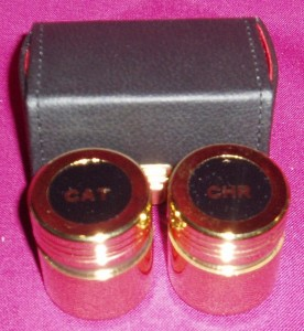 2 holy oil containers in a leather case.