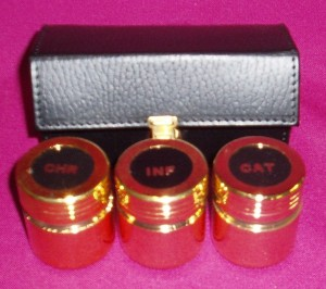 3 holy oil containers in a leather case.