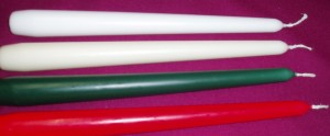 Prices tapered dinner candles, made in England. Available in white, cream, red and green.