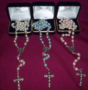 Imitation Pearl Rosary, in a very attractive case. Available in pink, white and blue.