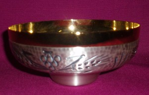 CW2884: Silver and gold paten ciborium with grapes and wheat motif.