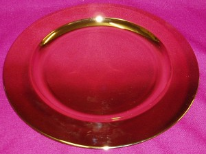 Large gold paten with a diameter of 240mm.