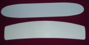 Collar inserts for Clerical shirts. One is plastic, the other has a linen look and feel to it.
