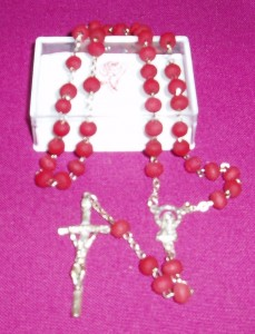 Perfumed rosary; with a delightful rose scent to the beads.