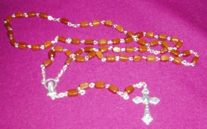 Rectangular wooden rosary beads, available in black and brown.