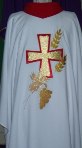 White Chasuble with red collar; cross, grapes and wheat embroidered motifs.