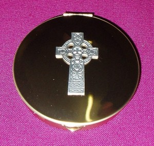 Gold Pyx with celtic cross emblem on the lid; holds approx 20 hosts