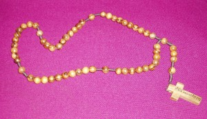 Olive Wood Rosary, from the Holy Land, made by the Palestinian Christians. Wooden beads on a cord, with a plain cross.