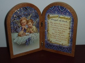 A folding plaque with the prayer to the guardian angel. A lovely baptism gift.