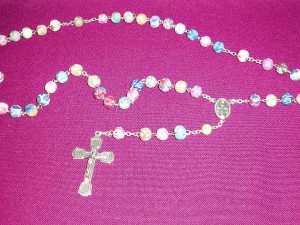 A gift rosary with multi coloured clay beads